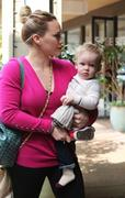 http://img295.imagevenue.com/loc574/th_518341373_Hilaty_Duff_Takes_baby_Luca_to_a_play_date25_122_574lo.jpg